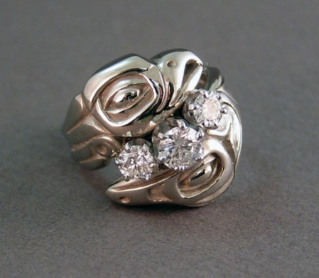 Photo of top view of Lovebirds ring with 3 diamonds equaling 1 full carat.