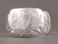 Photo of Hand carved Sterling Totem Bracelet showing the Raven end