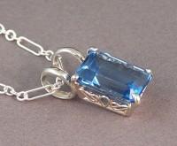 Katy's Blue Topaz in a Sterling Silver Custom Crown