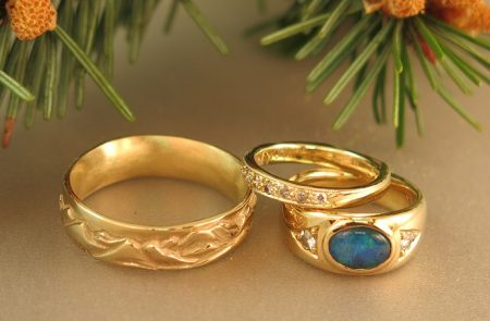 Opal and diamonds Engagement and Wedding Rings with a NW Mountain Range Wedding Band