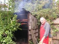Owen Walker puts Sockeye Salmon in his Smokehouse