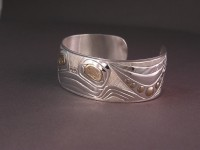 Photo of Hand carved sterling silver and 18Kt gold bracelet