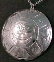 Hand carved sterling silver Sun mask pendant by Owen Walker