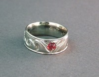 Photo pf Walker Goldsmiths Surfer Ring with Sunstone, waves and mountains