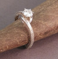 14kt white gold hand engraved engagement ring with 1/2ct stone by Owen Walker